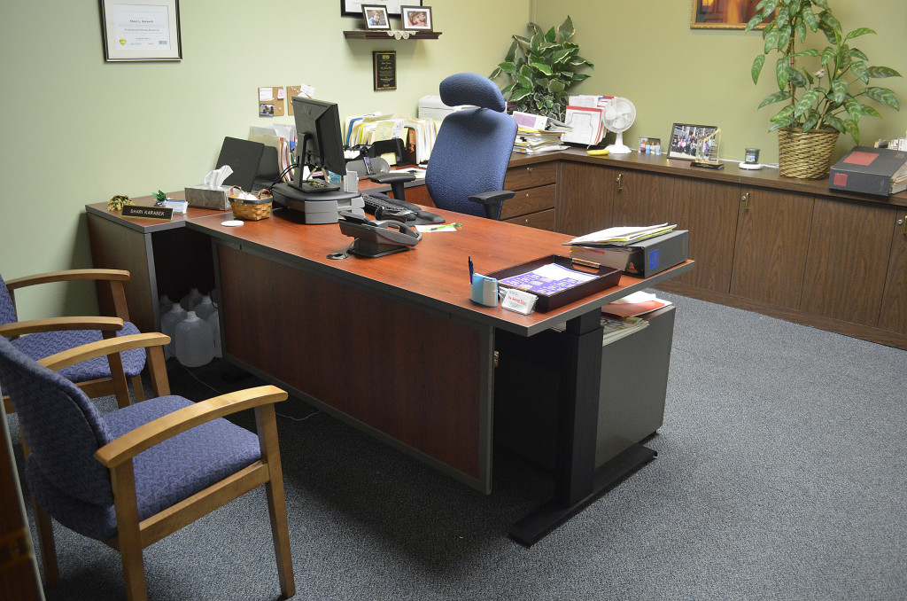 Shari Karasek received a height-adjustable private office to match her existing cabinetry.  Here the desk is shown at seated height.
